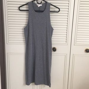 A gray, tight fitting dress.